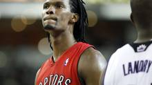 Toronto Raptors forward Chris Bosh, left, looks at the scoreboard late in the second half of an NBA basketball game against the Sacramento Kings in Sacramento, Calif. (Steve Yeater/Steve Yeater/AP)