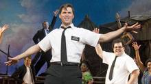 In this publicity image released by Boneau/Bryan-Brown, Andrew Rannells performs with an ensemble cast in The Book of Mormon at the Eugene O'Neill Theatre in New York. (Joan Marcus/Joan Marcus / AP)