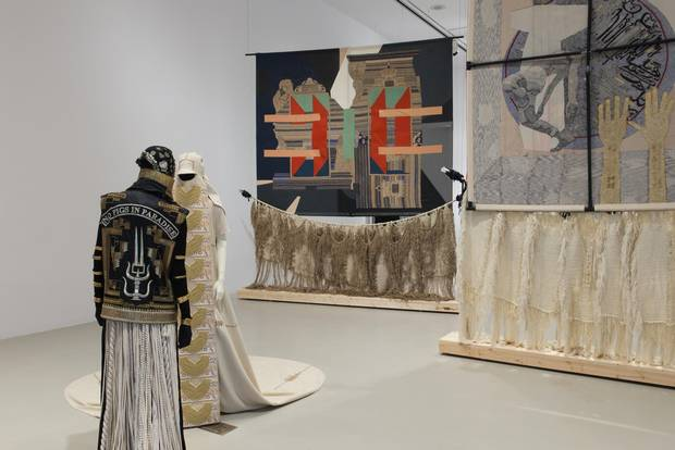 The first piece of work visitors encounter at the gallery are a collaboration between Nep Sidhu and Tlingit/Unanga artist Nicholas Galanin. SHE in Light Form, No Pigs in Paradise and SHE in Shadow Form, No Pigs in Paradise are two sculptural figures, posed opposite each other as if balancing the room, costumed and adorned with emblems traditional of Sikh and First Nations cultures.