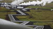 In Iceland, giant ducts carry superheated steam from within a volcanic field to turbines at Reykjavik Energy's Hellisheidi geothermal power plant. (Brennan Linsley/Associated Press)