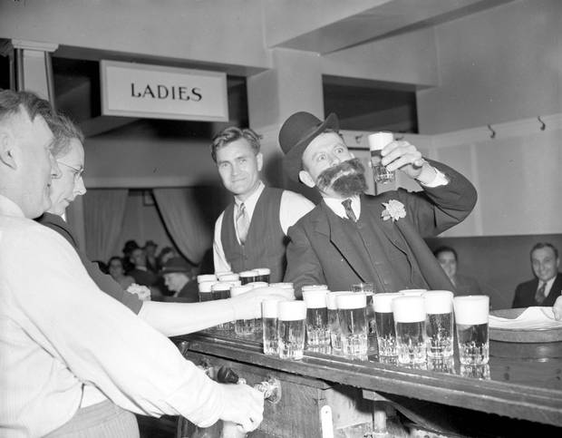 Patrons partake in libations at the Kinsmen Carnival beer parlour in Revelstoke, B.C., on June 30, 1944.