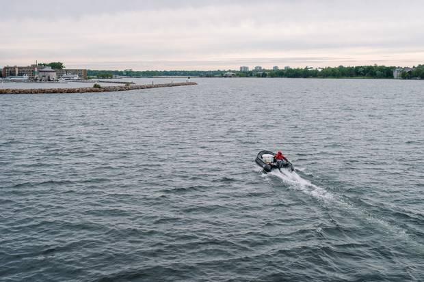 A zodiac from Canada C3 heads toward Kingston's Confederation Basin Marina.