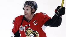 Ottawa Senators' Daniel Alfredsson celebrates his 400th career goal after scoring against the Calgary Flames in overtime during their NHL hockey game in Ottawa December 30, 2011 (Reuters)