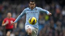 Manchester City soccer player Carlos Tevez (Jon Super/The Associated Press)
