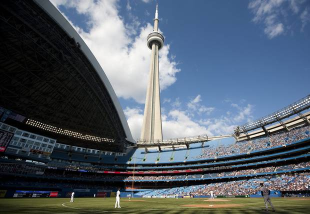 The CN Tower looms over the Toronto Blue Jays and Detroit Tigers as the Rogers Centre's roof is open for the first time in the 2011 MLB baseball season in Toronto Saturday, May 7, 2011.