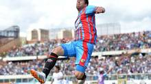 Catania midfielder Mariano Izco celebrates after scoring during the Serie A soccer match between Catania and Roma at the Angelo Massimino stadium in Catania, Italy, Sunday. (Carmelo Imbesi/AP)