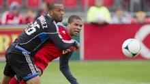 Toronto FC 's Ryan Johnson (right) battles for the ball with South Jose Earthquakes' Victor Bernardez during first half MLS action in Toronto on Saturday, March 24, 2012. (Chris Young/THE CANADIAN PRESS)
