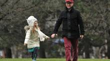 Chad Sapieha walks with his daughter Scarlett near his Toronto home earlier this month. (J.P. MOCZULSKI For The Globe and Mail)