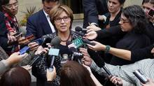 B.C. Premier Christy Clark, shown at a media scrum Monday, is in Calgary to discuss the Northern Gateway pipeline with her Alberta counterpart, Alison Redford. (Jeff McIntosh/THE CANADIAN PRESS)