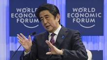 Japanese Prime Minister Shinzo Abe at the World Economic Forum in Davos, Switzerland, Wednesday, Jan. 22, 2014. Leaders gathered in the Swiss ski resort of Davos have made it a top priority to push to reshape the global economy and cut global warming by shifting to cleaner energy sources. (Michel Euler/AP)