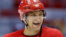 Russia forward Alexander Ovechkin laughs with teammates during a training session at the 2014 Winter Olympics, Monday, Feb. 10, 2014, in Sochi, Russia. (Julie Jacobson/AP)