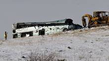 A tour bus that careened off a mountain highway and plunged down a snow-covered slope, killing nine passengers and injuring at least 27 others is recovered in Pendleton, Oregon on December 31, 2012. The charter bus was carrying about 40 people through the Blue Mountains of northern Oregon en route from Las Vegas to Vancouver, British Columbia, when it crashed through a guard rail on Interstate 84 on Sunday morning, authorities said. (STEVE DIPAOLA/Reuters)