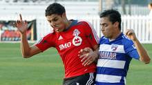 FC Dallas' Bruno Guarda (8) fights for the ball withToronto FC's Luis Silva (11) during the first half of a soccer match in the Walt Disney World Pro Soccer Classic, Thursday, March 1, 2012, in Lake Buena Vista, Fla. (Reinhold Matay)