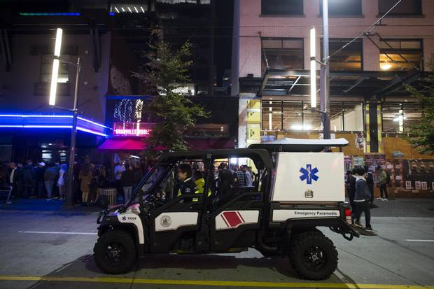 Paramedics on a utility vehicle sit on Granville Street.