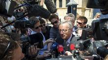 Long-time Prime Minister Jean-Claude Juncker talks to the media after his meeting with Grand Duke Henri at the Grand Ducal Palace in Luxembourg July 11, 2013. The Luxembourg government bowed to pressure for an early election after the junior coalition partner blamed Juncker for failing to curb abuses of power by the secret service. (STRINGER/REUTERS)