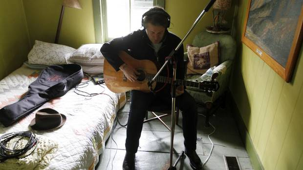 Jim Cuddy of Blue Rodeo records an over-dub at his band-mate Greg Keelor's farmhouse in Kendal, Ont., northeast of Toronto. The alt-country troupe recently issued Blue Rodeo: 1987-1993, an eight-disc box set commemorating the group's 25-year recording career. (Fernando Morales/The Globe and Mail)