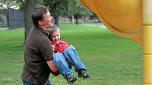 Epileptic Brian Machin, shown playing with his 5-year-old son Rhys, had brain surgery in 2006. He hasn't had a seizure since. (Fernando Morales/The Globe and Mail)