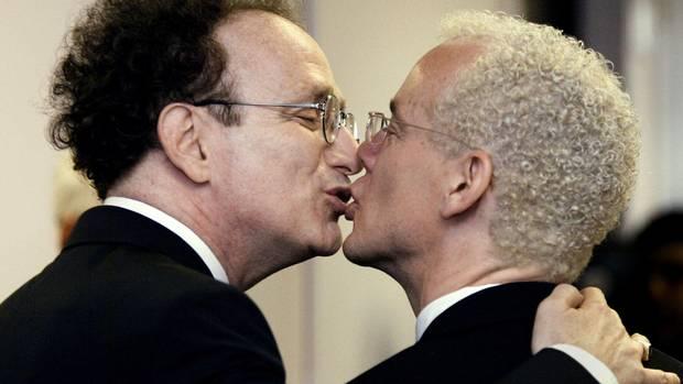 Michael Leshner (L) kisses his same-sex partner Michael Stark after being ...