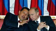 Venezuela's late president Hugo Chavez, left, and Russia's Vladimir Putin. (Mikhail Metzel/AP)