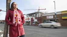 Annie MacInnis, executive director of the Kensington Business Revitalization Zone, seen on 10th Street N.W. in Calgary. The historic Kensington neighbourhood has two new mixed-use projects going up, and another 13 developments at the proposal stage, says Ms. MacInnis, who represents the interests of Kensington's 280 businesses. (Chris Bolin for The Globe and Mail)