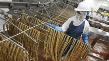 Maple Leaf Foods is still slogging through its restructuring, promising to be out of the woods by 2015. (Peter Power/The Globe and Mail)