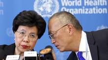 Margaret Chan, director-general of the World Health Organization, joins Keiji Fukuda, assistant director-general for health security, at a press conference in Geneva on Aug. 8, 2014. (SALVATORE DI NOLFI/ASSOCIATED PRESS)
