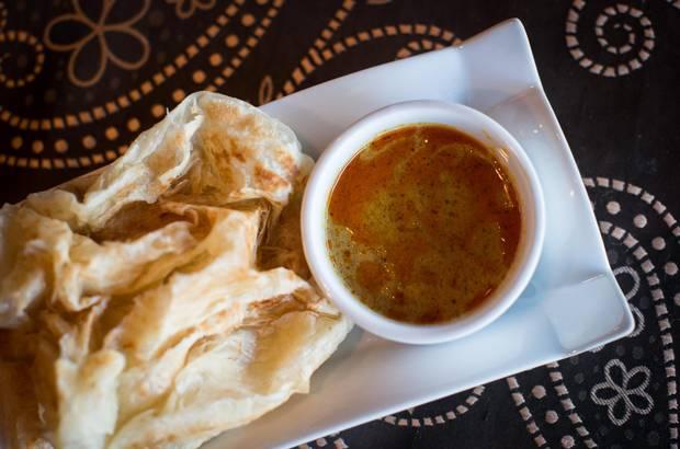 Roti canai with regular curry sauce.