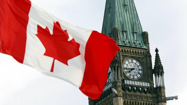 The Canadian flag flies on Parliament Hill in this file photo.