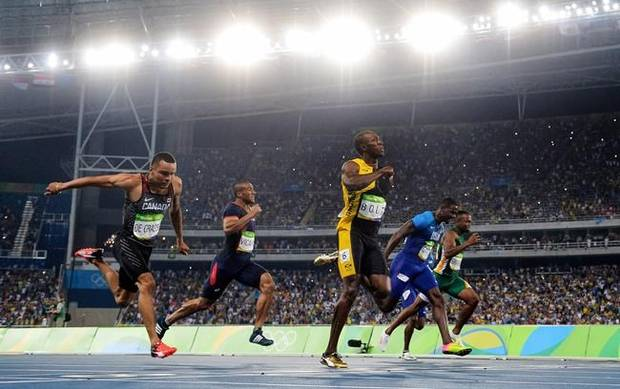 Canada's Andre De Grasse, France's Jimmy Vicaut, Jamaica's Usain Bolt, United States' Justin Gatlin and South Africa's Akani Simbine race in the men's 100-metre final during the athletics competition at the 2016 Olympic Games in Rio de Janeiro, Brazil on August 14, 2016. Bolt won gold, Gatlin won silver and De Grasse won bronze.