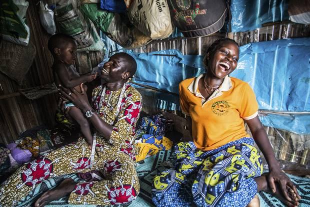 Simplicia Zannou and her husband, Bourasma Kokossou, play with their son Midokpe at home.