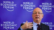 World Economic Forum (WEF) founder and executive chairman Klaus Schwab gestures during a news conference (FABRICE COFFRINI)