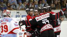 Team Canada's Micki Dupont (3rd L) and his teammates celebrate as goalkeeper Dominik Hasek (L) of Spartak Moscow stands beside after Dupont scored during their ice hockey match at the Spengler Cup tournament in the Swiss mountain resort of Davos December 27, 2010. (ARND WIEGMANN/REUTERS)