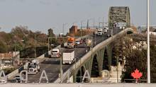Traffic works its way up the Peace Bridge on the way to Buffalo, New York, in 2011. Canada's trade deficit in May, 2013, narrowed to $303-million from $951-million in April. (Glenn Lowson For The Globe and Mail)