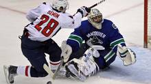 Vancouver Canucks' Roberto Luongo, right, stops Washington Capitals' Alexander Semin, of Russia, on a penalty shot during third period NHL action in Vancouver, B.C., on Friday December 18, 2009. THE CANADIAN PRESS/Darryl Dyck (DARRYL DYCK)