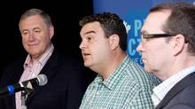 Dean Del Mastro, MP for Peterborough, flanked by MPs Daryl Kramp, left, and Barry Devolin, gives a press conference on Wednesday, July 4, 2012. (Peter Redman/The Canadian Press)