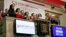Employees and guests of Silvercorp Metals attend the opening bell at the New York Stock Exchange March 8, 2010. The company is also listed on the Toronto Stock Exchange. (Mark Lennihan/The Associated Press)