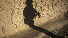The shadow of a Canadian soldier from the NATO-led coalition is cast on a mud wall shortly before his patrol came under fire in the Taliban stronghold of Kolk in Zahri district, Kandahar province, southern Afghanistan, November 15, 2007. (FINBARR O'REILLY/REUTERS/FINBARR O'REILLY/REUTERS)