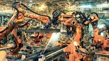 Robots weld door components onto the Dodge Caravan and Chrysler Town & Country at the Chrysler assembly plant in Windsor, Ont. (Jerry S. Mendoza/AP)