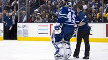 Toronto Maple Leafs goaltender Jonathan Bernier is helped off the ice after being injured during third period NHL action against the Boston Bruins in Toronto on Thursday April 3, 2014. (The Canadian Press)