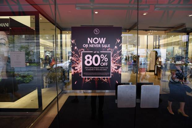 A sale sign at a Holt Renfrew location on Toronto's Bloor Street.