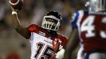 Calgary Stampeders Kevin Glenn (15) throws a pass against the Montreal Alouettes during the second half of their CFL game in Montreal July 12, 2012. (OLIVIER JEAN/REUTERS)
