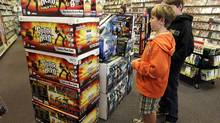Guitar Hero and Rock Band 2 video game bundles are seen on display at a GameStop store in Redwood City, Calif., Wednesday, Dec. 17, 2008. (Paul Sakuma/AP)