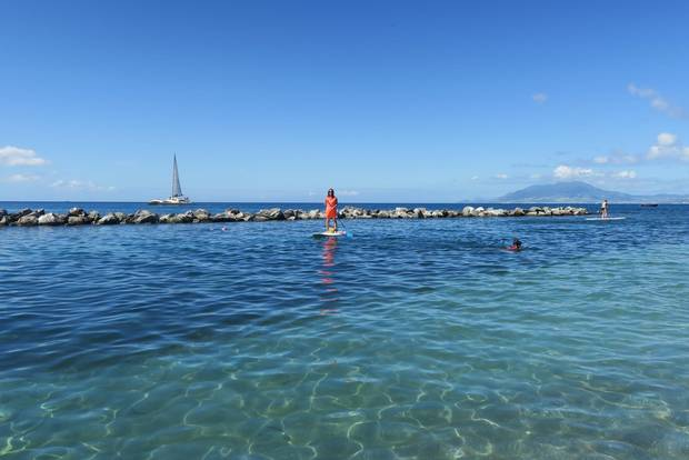 The absence of strong currents on the west side of Nevis makes for a relaxing stand-up paddle board ride.