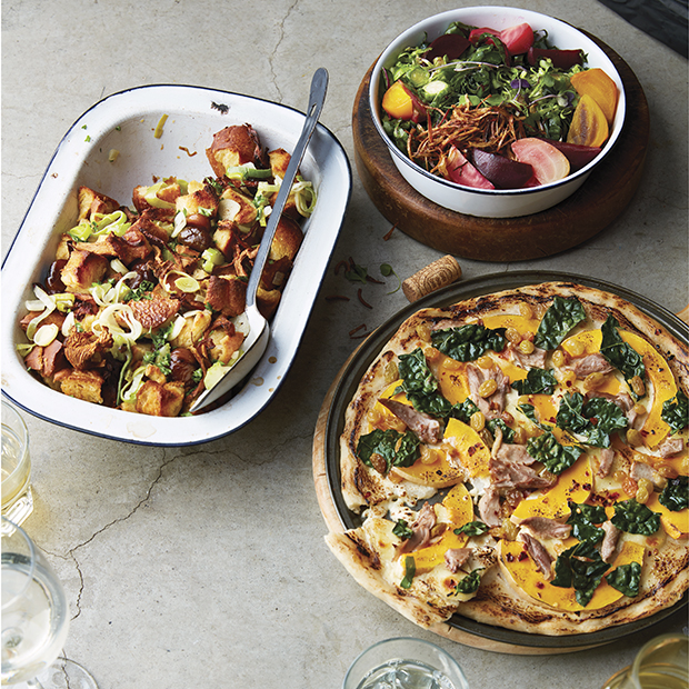 Clockwise, from top left: Brown butter brioche stuffing with chestnuts, leeks and chanterelles; roasted beets, shredded chard and brassica salad; squash and duck pizza.