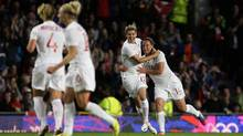 Canada's Christine Sinclair, centre, celebrates with teammate Melissa Tancredi, right, after scoring her second goal against the United States during their semi-final women's soccer match at the 2012 London Summer Olympics, Monday, at Old Trafford Stadium in Manchester, England. (Jon Super/AP)