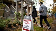 Potential buyers arrive for an open house in the Kitsilano neighbourhood in Vancouver, British Columbia, Sunday, October 14, 2012. (Rafal Gerszak For The Globe and Mail)