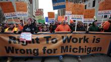Union members and supporters march to the Michigan State Capitol building to protest against right-to-work legislation in Lansing, Michigan December 11, 2012. The Republican-majority Michigan legislature on Tuesday approved laws that ban mandatory membership in public-and-private sector unions, dealing a stunning blow to organized labor. (REBECCA COOK/REUTERS)