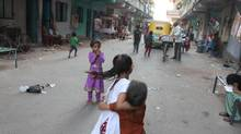 Children play in the streets of a resettlement community for survivors of anti-Muslim violence that tore through Gujarat in 2002 on the outskirts of Ahmedabad, the state's largest city. (IAIN MARLOW/THE GLOBE AND MAIL)