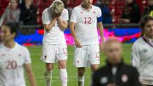 Sophie Schmidt and Christine Sinclair of Canada's women's soccer team reacts after losing a heartbreaking loss to USA at the 2012 Summer Olympics in Manchester, England, Monday August 6, 2012. (Kevin Van Paassen/The Globe and Mail)