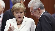 Germany's Chancellor Angela Merkel, left, talks to Italy's Prime Minister Mario Monti during a European Union leaders summit in Brussels, June 29, 2012. Euro zone leaders agreed on Friday to take emergency action to bring down Italy's and Spain's spiralling borrowing costs and to create a single supervisory body for euro zone banks by the end of this year, a first step toward a European banking union. (François Lenoir/Reuters)